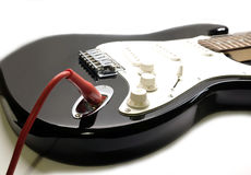 Part of modern electric six string guitar black color closeup Royalty Free Stock Photo