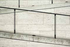 Part of a modern facade of travertine with staircase and elegant railings and floor lights Stock Photo