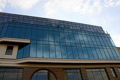 Part of a modern glass building against the sky Royalty Free Stock Images