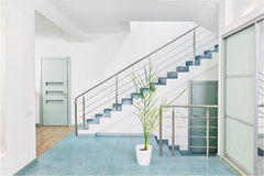 Part of modern hall interior with metal staircase Royalty Free Stock Photography