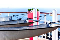 Modern hammocks in front of sea background Royalty Free Stock Photos