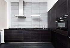 Part of modern minimalism style kitchen. Interior in monochrome tones Royalty Free Stock Photography
