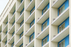 Part of a modern multi-storey office building with balconies and windows Stock Image