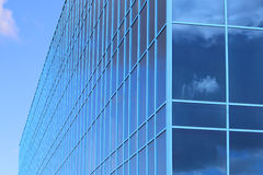 Part of modern new building with windows with reflected sky Stock Images