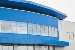 Part of a modern office building blue and white in color. Royalty Free Stock Images