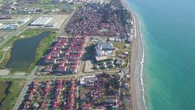Part of the modern resort town near the sea on a sunny day. Clip. Top view of the resort town near the sea.  stock video