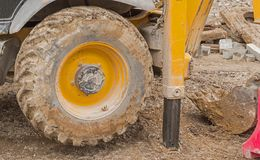 Yellow excavator machines. Part of modern yellow excavator machines Royalty Free Stock Images