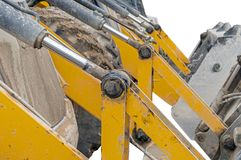 Part of modern yellow excavator machines isolated on white. Background Royalty Free Stock Photos