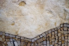 Part of the mosaic on the wall. Mosaic on the bottom side of the stone wall Royalty Free Stock Photos