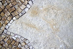 Part of the mosaic on the wall. Mosaic on the left side of the stone wall Royalty Free Stock Photo