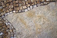 Part of the mosaic on the wall. Mosaic on the left side of the stone wall Stock Photos
