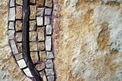 Part of the mosaic on the wall. Mosaic on the left side of the stone wall Stock Photo