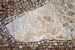 Part of the mosaic on the wall. Mosaic on the left side of the stone wall Stock Photography