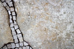 Part of the mosaic on the wall. Mosaic on the left side of the stone wall Royalty Free Stock Image