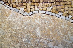 Part of the mosaic on the wall. Mosaic on the upper side of the stone wall Royalty Free Stock Photography