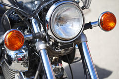 Part of motorcycle headlight. Detail of Motorbike. Part of motorcycle  headlight. Detail of Motorbike. Outdoors Royalty Free Stock Photos