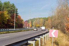 Part of the motorway with forest on both sides autumn Royalty Free Stock Photos