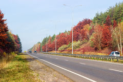 Part of the motorway with forest on both sides autumn Stock Image