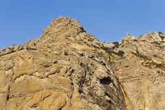 Part of the mountain range in the quaint fractures of volcanic rock Stock Photography