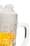 Part of a mug with beer Royalty Free Stock Image