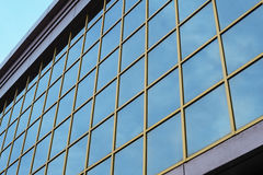 Part of a multi-storey glass office building against the sky Royalty Free Stock Image