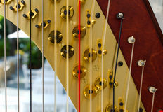 Part of musical instrument called harp Royalty Free Stock Photo