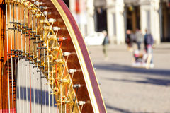 Part of musical instrument called harp in abstract background . Stock Photography