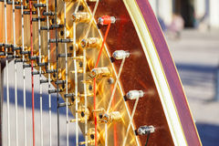 Part of musical instrument called harp in abstract background . Royalty Free Stock Image