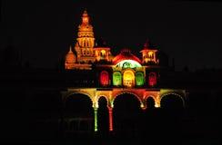 Part of Mysore Palace in India illuminated. The ancient Mysore Palace in India is illuminated colorfully every night Stock Image