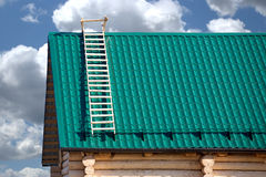 Part of new country house from logs and green metal tile roof Stock Photo