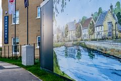 Newly built show homes and banner seen in front of a large, advertising barrier. Royalty Free Stock Photos