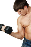 Part Of A Body The Young Man Lifting Dumbbells Royalty Free Stock Photos