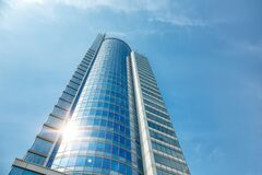 Free Part Of A Super Modern Business Building Against The Blue Sky Royalty Free Stock Image - 181899296