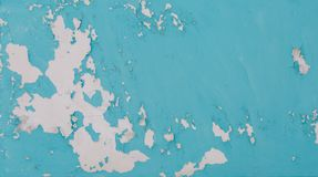 Part Of The Building`s Wall Covering With Turquoise Chipped Paint As A Background Or A Backdrop Royalty Free Stock Photo