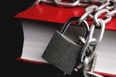 Part Of The Red Book Which Has A Chain Connected To The Chain Hanging Lock Stock Image