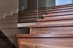 Free Part Of Wooden Steps With Glass Railings. Walnut Staircase Stock Photography - 142834142