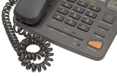 Part of office phone with cord. Part office phone with cord isolated on white background Stock Photo