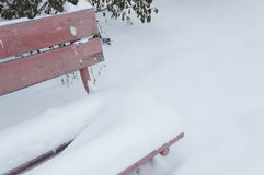 Part of Old bench. With fading colors in snow Royalty Free Stock Images
