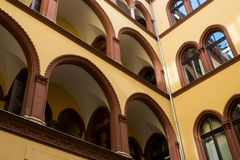 Part of an old building with arched balconies Royalty Free Stock Photography