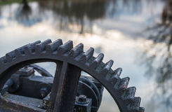 Part of an old cast iron gear Stock Photos