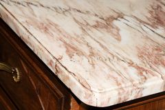 Part of an old chest of drawers with a marble surface royalty free stock photography
