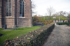 Part of old church and farmhouse in holland Stock Images