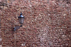 Part of the old city wall with lantern Royalty Free Stock Photo