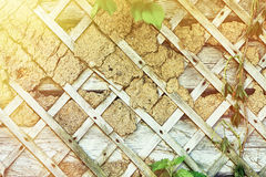 Part of the old destroyed wall with straps in the form of rhombuses. Royalty Free Stock Image