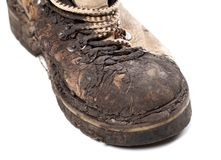 Part of old dirty hiking boot on white background Stock Photography