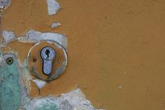 Part of an old door with a keyhole. Stock Photo