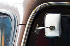 Part of old dusty car and the car mirror Royalty Free Stock Photo
