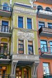 Part of the old house with balconies and windows on the colored facade Royalty Free Stock Image