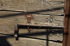 Part of old Mediaeval door. Mediaeval door and bolt in the Asinelli Tower Bologna Stock Photo
