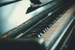Part of the old piano in vintage style. Stock Photos